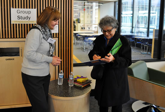 Arlene Alda signing copy of her book