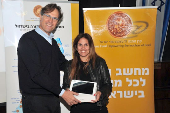 Uri Ben-Ari, founder and president of Athena Fund, gives an iPad to special education techer