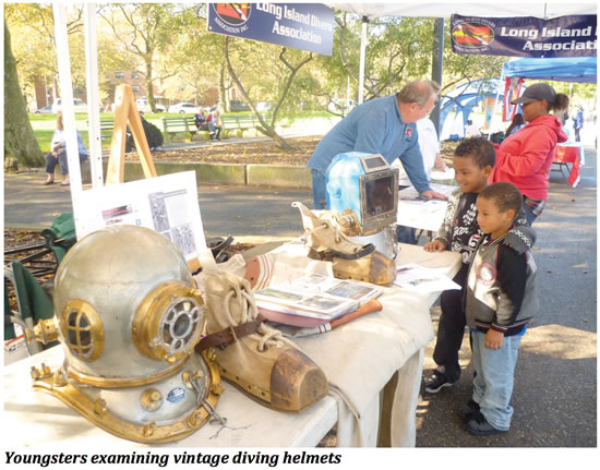 Youngsters examining vintage diving helmets